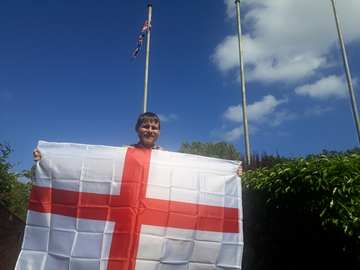 Stephen O'Brien with an England flag outside Sunderland Civic Centre ()