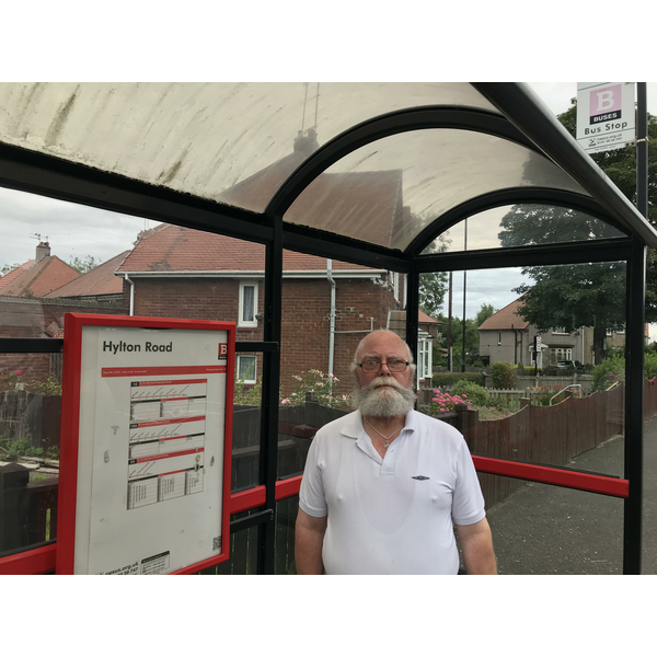Councillor George Smith at a bus stop on Hylton Road ()